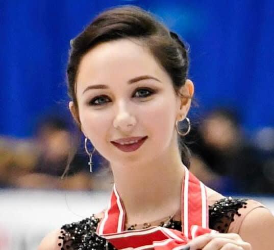 背中に「愛」の文字 24歳トゥクタミシェワが銀に涙「アメイジング」 フィギュアスケート世界選手権 画像